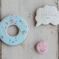 Sprinkle doughnut, and ring, you complete me speech bubble biscuit