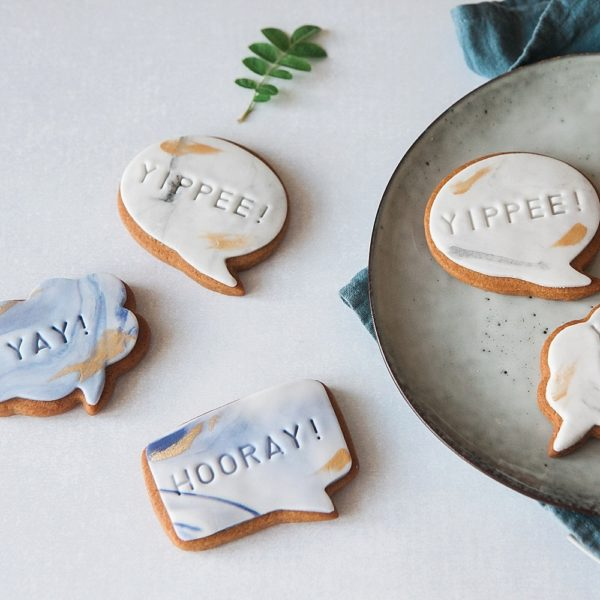 Marble and gold message biscuits to say congratulations